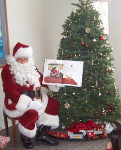 Reading his favorite story, T'was the night before Christmas.jpg